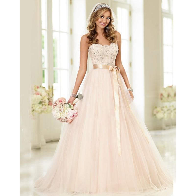 a48d6fb8064 Krémové tylové svatební šaty s champagne stuhou s bohatou sukní